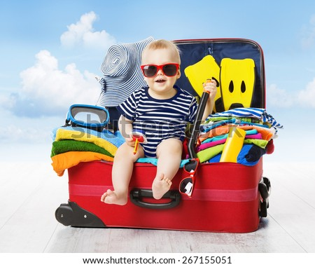 Baby boy and Travel Suitcase. Kid and Luggage Packed for Vacation Full of Clothes, Child and Family  Stock photo © galitskaya