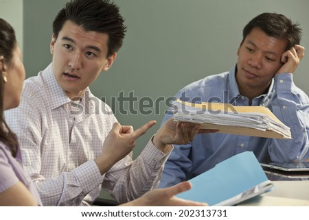 Side view of diverse business colleagues discussing plans over laptop in modern office Stock photo © wavebreak_media