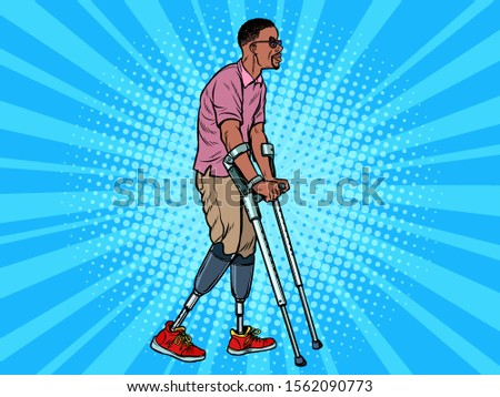 legless veteran with a bionic prosthesis with crutches. a disabled man learns to walk after an injur Stock photo © studiostoks