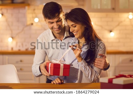 A pair of lovers in anticipation of the celebration of the new year on the background of decorated h stock photo © ElenaBatkova