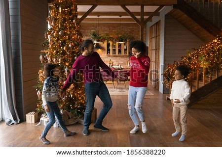 Family of two people mother and on new year's eve near the decorated Christmas tree sitting on the f Stock photo © ElenaBatkova