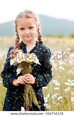 Little girl 3-5 years old in the summer in the field with yellow spikelets in a yellow swimsuit Stock photo © ElenaBatkova
