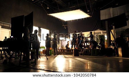 A silhouette of a videographer in studio working with a virtual interface. Stock photo © ConceptCafe