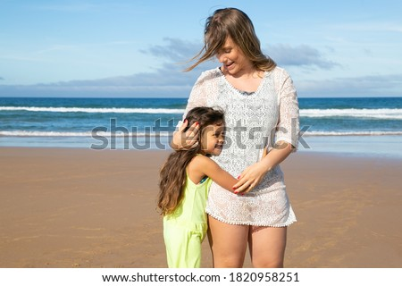Front view of caucasian woman standing on beach while looking at camera  Stock photo © wavebreak_media