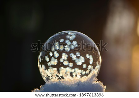 Winter holiday gifts and glowing snow on frozen blue background, Stock photo © Anneleven