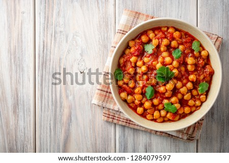 Chana Masala: Traditional Indian dish with chickpeas and curry Stock photo © joannawnuk