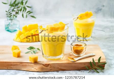 Mango Lassi, yogurt or smoothie. Healthy probiotic Indian popula Stock photo © joannawnuk