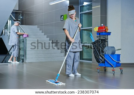Cleaner man mopping the floor in a hall Stock photo © Kzenon