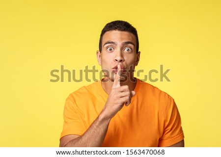 Hush dont say anyone. Handsome man have secret asking swear not tell anyone, prepare surprise new ye Stock photo © benzoix