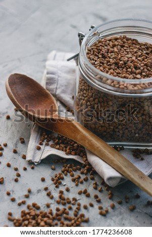 Top view of sprouted buckwheat in glass jar and on grey background. Vegan food. Healthy nutrition co Stock photo © vkstudio