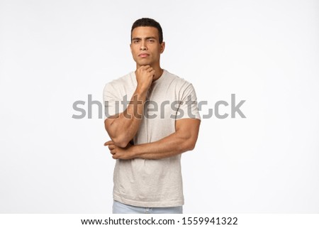 Skeptical, suspicious handsome strong man in t-shirt, have doubts, hold arm under chin, squinting su Stock photo © benzoix