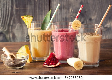 Glass of yellow fruit smoothie juice with chia seeds for diet de Stock photo © Anneleven
