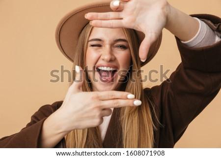 Kép fiatal lány visel kalap nevet fényképkeret Stock fotó © deandrobot