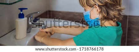 Boy washes his hands with soap. Boy in a medical mask due to coronavirus. Pandemic. Stay home. Wash  Stock photo © galitskaya