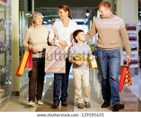 portrait of young man inside shopping mall with gift box waiting stock photo © hasloo