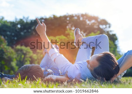 man lying in the park at his backyard stock photo © hasloo