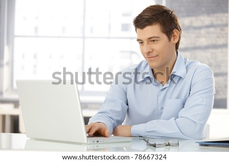 Portrait of young handsome good looking man working using keyboa Stock photo © HASLOO