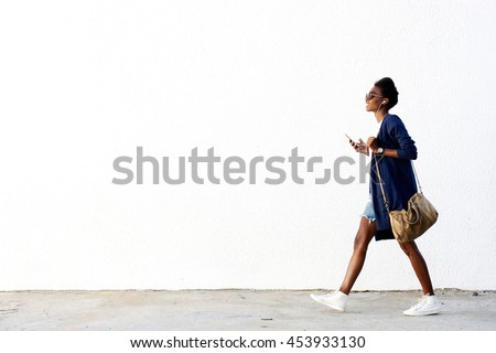 young woman walking stock photo © simply