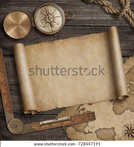 Vintage paper scroll with compass and rope on old wooden boards Stock photo © inxti
