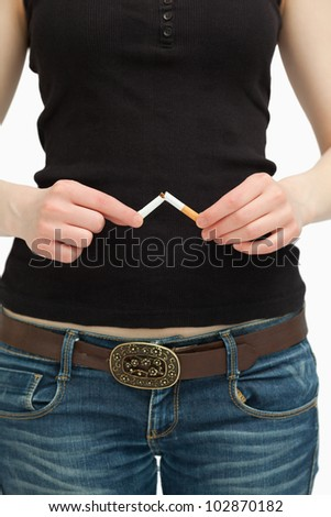 woman breaking a cigarette with her hands against white background stock photo © wavebreak_media