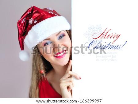 closeup of beautiful young women showing blank board and smiling Stock photo © get4net