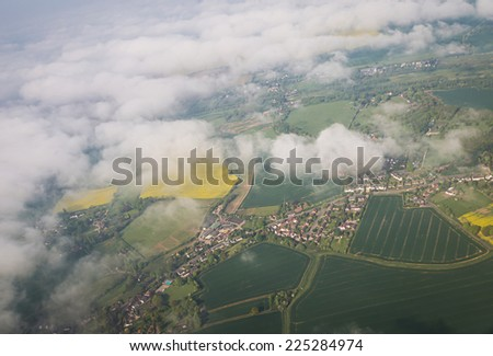 Blue cloudscape aerial view from aircraft as a land of sheeps clouds stock photo © lunamarina