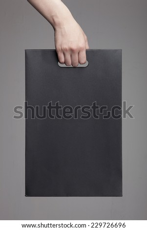 Shopping woman holding bags on studio background with thoughts c Stock photo © hasloo