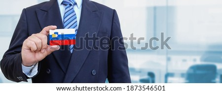 Slovenian Businessman holding business card with Slovenia Flag Stock photo © stevanovicigor