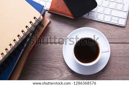 stack of newspapers and keyboard with cup of coffee close up stock photo © mizar_21984