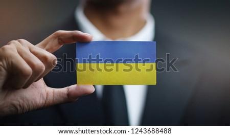 Ukrainian Businessman holding business card with Ukraine Flag Stock photo © stevanovicigor