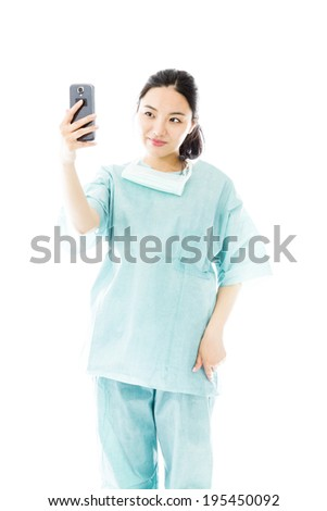 Asian female surgeon photographing herself with her mobile phone Stock photo © bmonteny