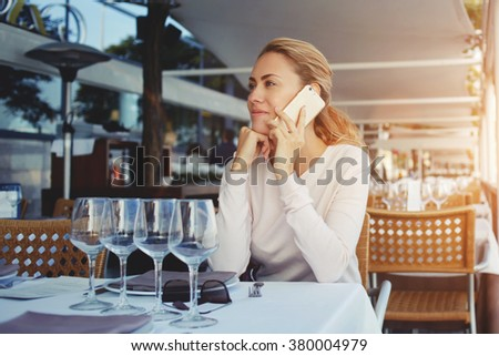 Pretty, young woman using her mobile phone/speaking on the phone Stock photo © lightpoet