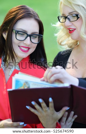 beautiful brown-haired woman with red folder and two young busin Stock photo © Paha_L
