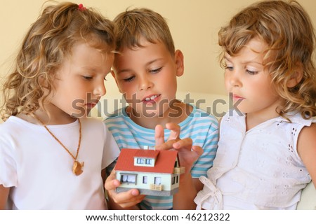 children three together keeping in hands model of house in cosy  Stock photo © Paha_L