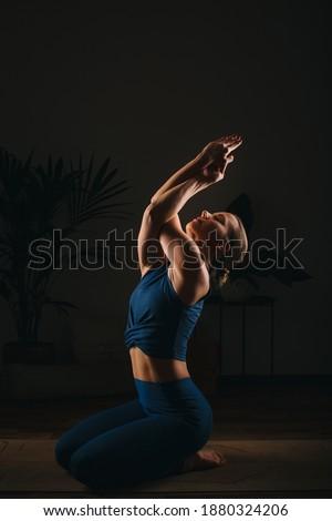 skinny model posing in dark studio background wearing sunglasses Stock photo © feedough