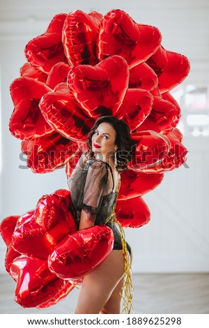 Makeup. Beautiful brunette girl in red with heart gift for Valen Stock photo © Victoria_Andreas