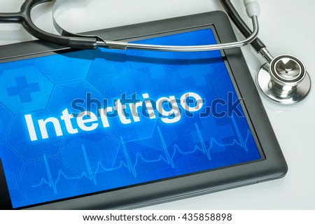 Tablet with the diagnosis Intertrigo on the display Stock photo © Zerbor