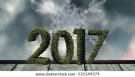 Stock photo: 2017 in grass on wooden plank against a composite image 3D of digitally generated background