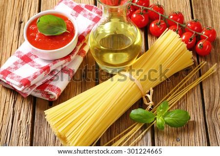 Dried spaghetti, tomato puree and olive oil Stock photo © Digifoodstock