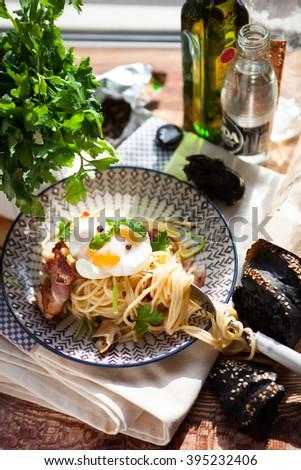Pasta Carbonara on plate with bacon and egg plows on dark wood b Stock photo © Yatsenko