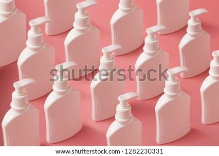 White unlabeled liquid soap bottles in supermarket, repeating pa Stock photo © stevanovicigor