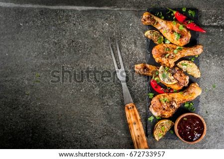 Grilled Chicken Legs And Wings With Barbecue Sauce And Mustard Stock photo © mpessaris