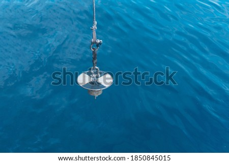 Stock photo: Water transpacency measurement disk with rope on a wooden dock
