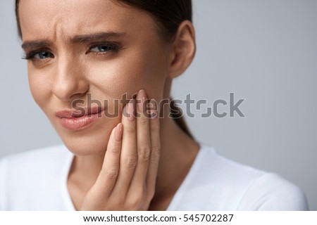 Closeup of beautiful young woman suffering from toothache, Denta Stock photo © eddows_arunothai
