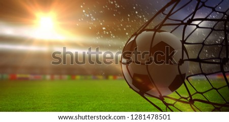 Soccer ball in goal net against digitally generated argentinian national flag Stock photo © wavebreak_media