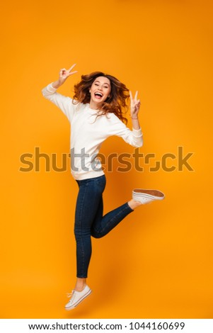Full length portrait of adorable young woman 20s with long brown Stock photo © deandrobot