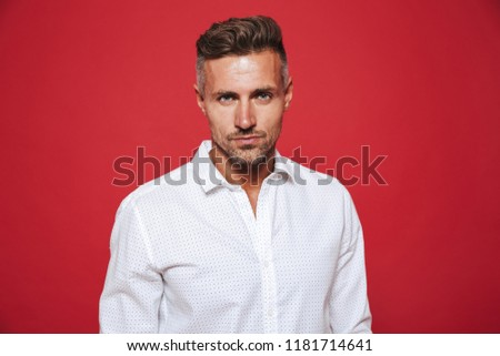 Fancy brunette man 30s with stubble in white shirt looking on ca Stock photo © deandrobot