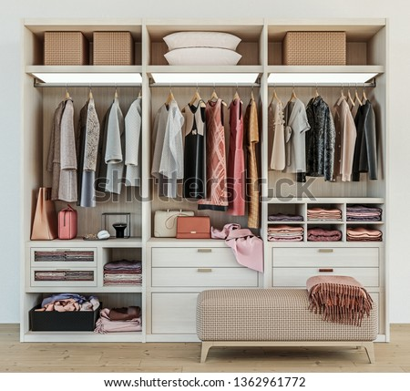 Walk-in closet with built in shelves, clothes rails and drawers Stock photo © iriana88w