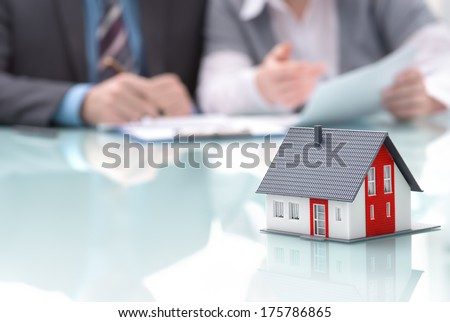 Businessman signs contract behind home architectural modelDiscu Stock photo © snowing