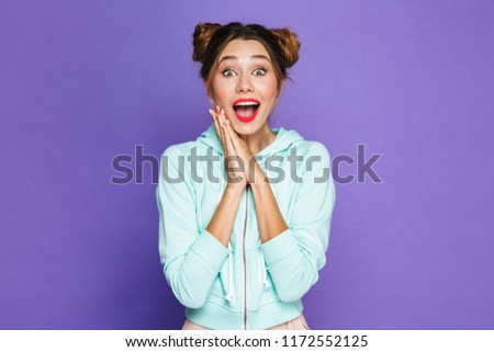 Image of excited woman with two buns laughing and keeping hands  Stock photo © deandrobot